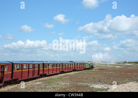 The miniature light railway steam train travelling along the beach railway at Dungeness, Kent, UK - Stock Photo