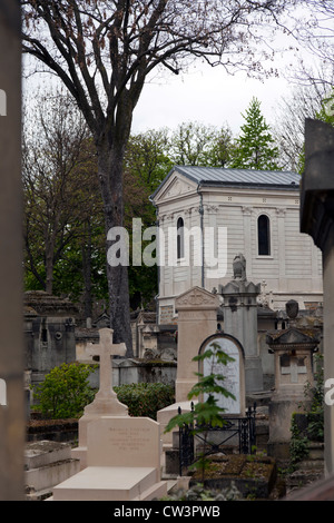 Tombs in Pere Lachaise cemetery, Paris, France - Stock Photo