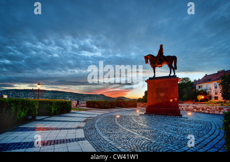 A statue of Hungarian patriot Görgey Artúr outside Buda Castle in Budapest, Hungary, at sunset - Stock Photo