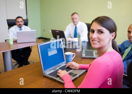 Portrait of a group of business executives in a conference - Stock Photo