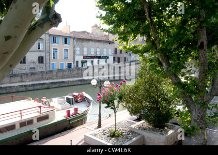 Barge on Canal de la Robine in centre of Narbonne Languedoc Roussillon South of France - Stock Photo