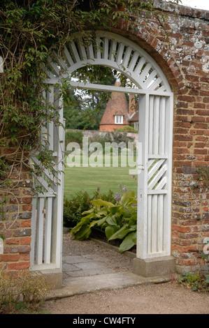 Gate entrance into a walled garden - Stock Photo
