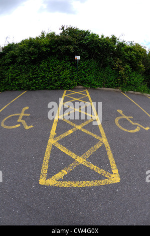 Disabled parking bays painted in yellow at a local car park. - Stock Photo