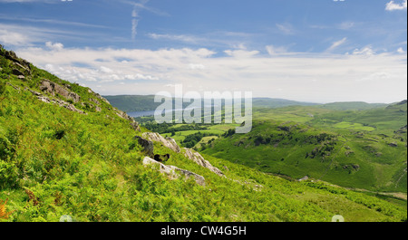 View over Coniston Water from Rascal How in summer in the English Lake District - Stock Photo