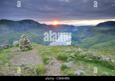 Stunning summer sunset over Buttermere and the summit of Fleetwith Pike in the English Lake District. - Stock Photo