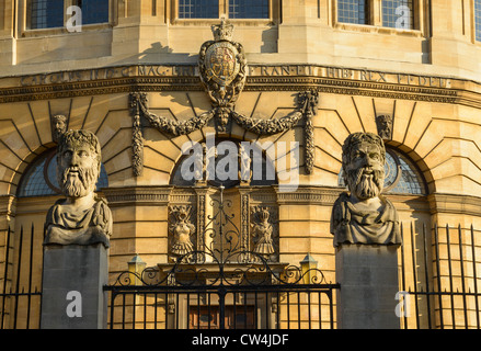 Sheldonian Theatre and classical heads Broad Street Oxford University UK - Stock Photo