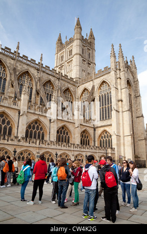 Foreign school teenagers students in the UK on a trip in front of the Abbey, Bath Somerset UK - Stock Photo