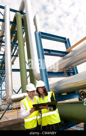 technicians working in industrial chemical plant, norfolk, england - Stock Photo