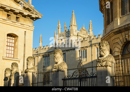 View from Broad Street of Sheldonian Theatre and Bodleian Library with great classical heads Oxford University UK