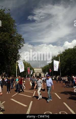 The Olympic flag as part of the London 2012 games with Admiralty arch in the background. - Stock Photo