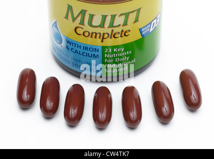 Multi vitamin supplements.  Seven pills, one for each day of the week - Stock Photo