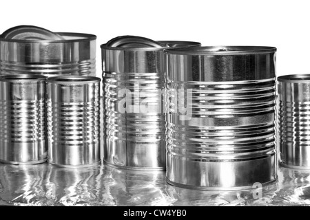 Assorted aluminum cans against white background - Stock Photo