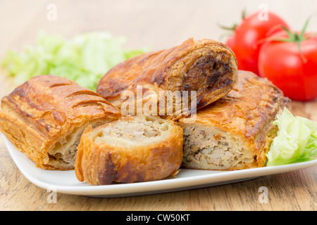 Sausage rolls in flaky puff pastry - Stock Photo