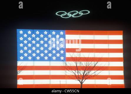 Olympic Rings and electric American Flag, Winter Olympics, Salt Lake City, Utah - Stock Photo