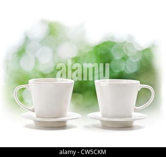 Cups on defocus summer background - Stock Photo