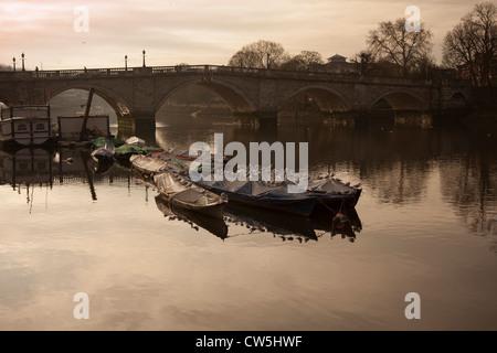 Boats on the river Thames,Richmond Bridge,Richmond-Upon-Thames,Surrey,UK - Stock Photo