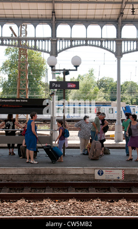 sncf train with passengers on platform in tgv railway station at stock photo royalty free image. Black Bedroom Furniture Sets. Home Design Ideas