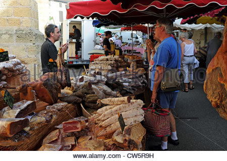 Shopping at the market at the small town of Prayssac in the Lot Region of South West France Europe - Stock Photo