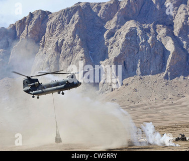 A CH-47 Chinook helicopter approaches a remote landing zone to drop off supplies March 10, 2012 in Shah Joy district, - Stock Photo