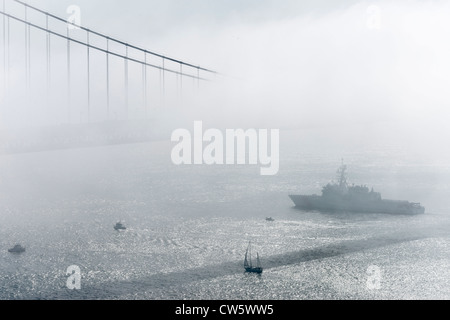 Fleet Week at Golden Gate Bridge, San Francisco, California. Naval and air displays. Ships sailing under bridge - Stock Photo