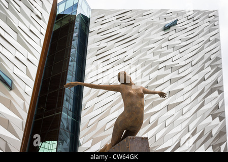 Titanica sculpture in front of Titanic Belfast visitor attraction and monument in Titanic quarter of Belfast, Northern - Stock Photo