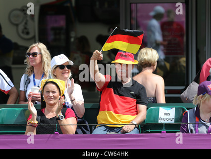 German fans with flag at the Olympic Tennis event at Wimbledon,London 2012, - Stock Photo