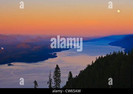 Aerial view over Johnstone Strait and Robson Bight, looking southeast after a beautiful soft sunset on a full moon - Stock Photo