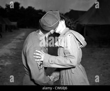 A U.S Army sergeant kisses goodbye U.S WAC (July 25,1945) - Stock Photo