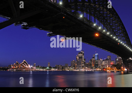 skyline of Sydney with Opera, Harbour Bridge and financial center at night, Australia, Sydney - Stock Photo