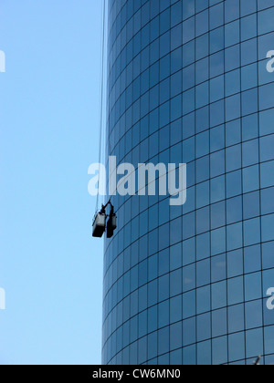 window cleaner on a sky scraper - Stock Photo