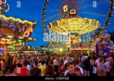 people on fun fair, Germany, North Rhine-Westphalia, Ruhr Area, Herne - Stock Photo