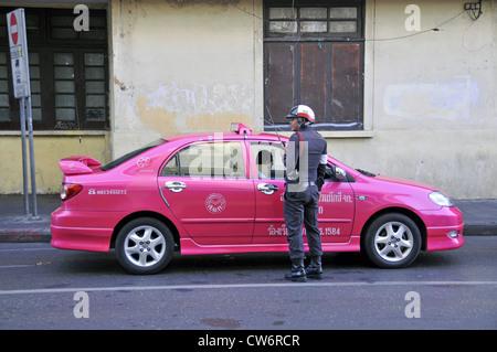 policemen controlling a car, Thailand, Bangkok - Stock Photo