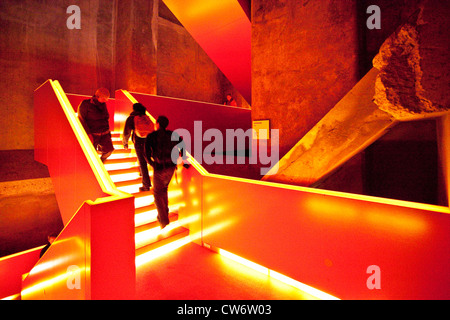 people in a staircase of coal plant Zollverein, Germany, North Rhine-Westphalia, Ruhr Area, Essen - Stock Photo