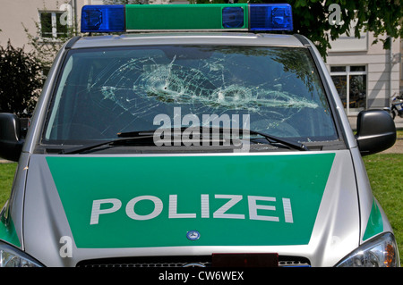 broken front shield of a police car during a demonstration agains Naonazi manifestation, Germany, Baden-Wuerttemberg, - Stock Photo