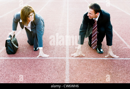 businesspeople at starting line looking at each other - Stock Photo