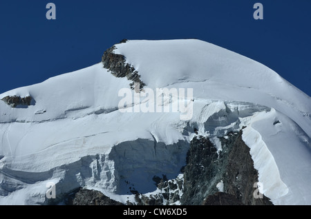 the summit and north face of the Allalinhorn in the southern swiss alps between Zermatt and Saas Fee. Showing a - Stock Photo