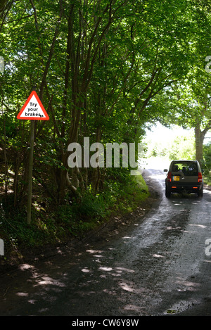 four wheel drive vehicle passing try your brakes warning sign after ford across road Bardsey Yorkshire UK - Stock Photo
