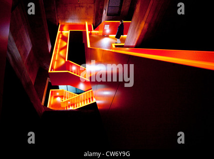 person in a staircase of coal mine Zollverein, Germany, North Rhine-Westphalia, Ruhr Area, Essen - Stock Photo