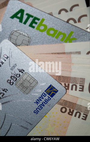 Credit cards in between euro banknotes. - Stock Photo