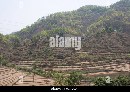 Electric transmission tower with stepped farming in Lansdowne, a large portion of the less steep slopes being used - Stock Photo