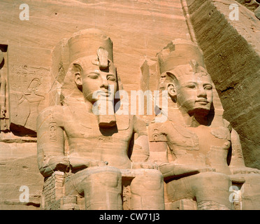 Abu Simbel, facade of the main temple, 2 of the 4 colossal statues of Rameses II, Egypt - Stock Photo