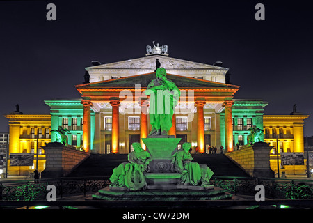 illuminated Schiller memorial in front of the Konzerthaus at Gendarmenmarkt, Germany, Berlin - Stock Photo