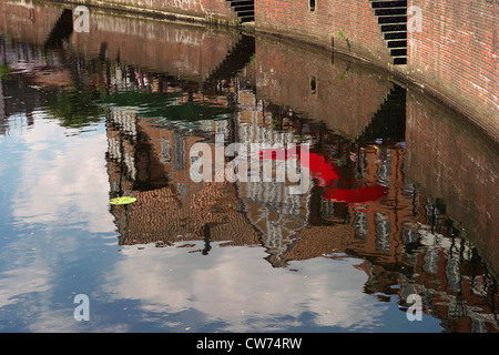 reflection of row of houses at the promenade in the water of the old hanse-harbor, Germany, Lower Saxony, Stade - Stock Photo