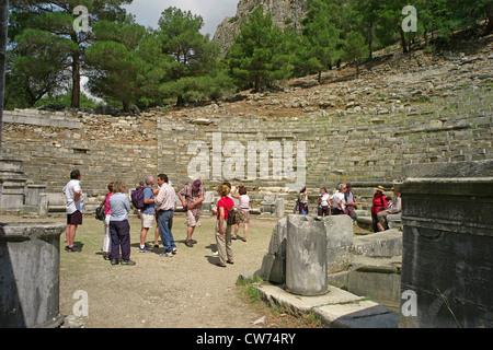 tourists in the ancient theatre of Priene, Turkey, West Anatolia, Priene - Stock Photo