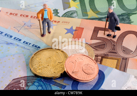 symbolic picture for pesion and provision for one's old age, little figures on bank notes - Stock Photo