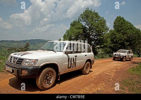 UN cross-country vehicles on dusty road, Burundi, Gitega, Gitega - Stock Photo