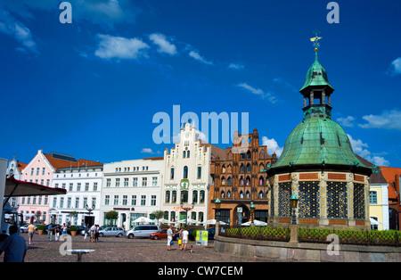 market place with Wismarer Wasserkunst, Germany, Mecklenburg-Western Pomerania, Wismar - Stock Photo