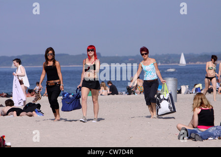 bathers on a sunlit Baltic Sea beach , Germany, Schleswig-Holstein, Travemuende, Luebeck - Stock Photo