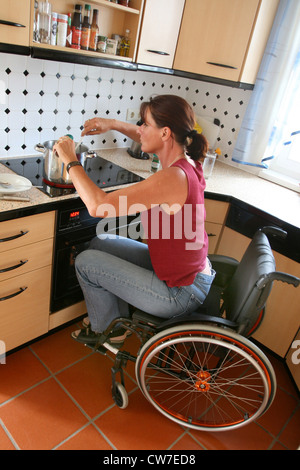 Woman In A Wheel Chair In The Kitchen Stock Photo Royalty Free Image 57009250 Alamy