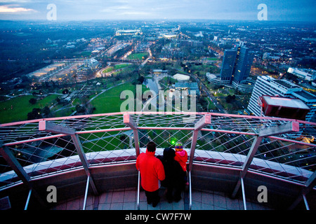 visitors on observation deck of television tower Florian and view to Westfalenpark, Germany, North Rhine-Westphalia, - Stock Photo